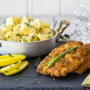 Combination Of Pork Schnitzel With The Tasty Potato And Mayonnaise Salad